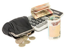 Money, purse and calculator on a white background Stock Images