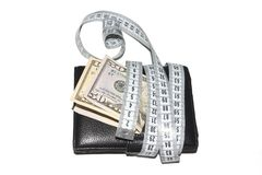 Money with purse is tied with measuring tape on white background. The concept of budget and money Stock Photography