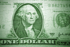 Money puzzle. U.S. one dollar banknote and jigsaw puzzle Stock Photography
