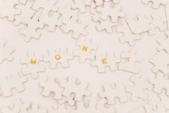Money Puzzle Stock Photos