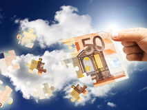 Money puzzle. Financial concept. Euro money in hand Stock Photography