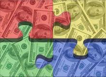 Money puzzle. Tri colored money puzzle pieces Stock Image