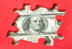 Money and puzzle Stock Image