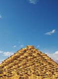 Money pyramid. Pyramid from money on a background sky Stock Photography