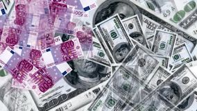 Money rain from the euro and dollars stock footage