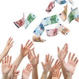 Money rain. Hands reaching for Euro money flying in the air stock photo