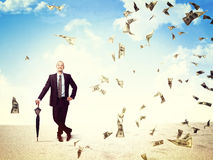 Money rain on me. Smiling man and 3d dollard money come from sky Royalty Free Stock Image