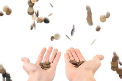 Money raining down on the hands Stock Photo