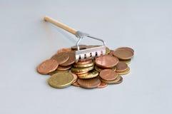 Money rake Stock Photos