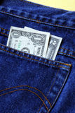 Money in the rear pocket of a blue jeans Stock Photography