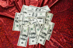 Money on red background Royalty Free Stock Images