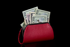 Money red change purse. American currency in red purse isolated on black Stock Photo