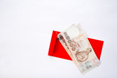 Money on Red envelope Royalty Free Stock Photography