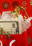 Money in a red gift bag Royalty Free Stock Photography