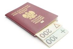 Money and red, polish passport on white background Stock Photography