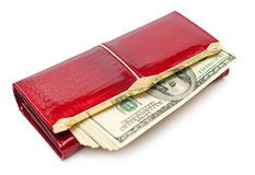 Money in the red purse. Dollars money in the red purse isolated on white background Royalty Free Stock Images