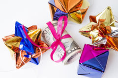 Money with red ribbon on a white background Stock Image
