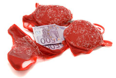 Money and red underwear Stock Photos