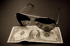 Money reflection in a sunglasses. Money reflection in a black sunglasses stock photo