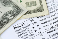 Money refunded on the tax return. Money refunded on the United States tax return Stock Photo