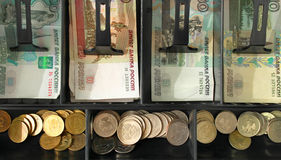 The money in the register. The drawer is open and visible cash Royalty Free Stock Photography