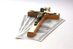 Money and religion Royalty Free Stock Photos