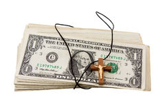 Money and religion. Wooden cross with a rope round the American money Stock Photography