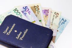 Money and religion. Conceptual image about money and religion Stock Photos