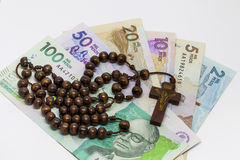 Money and religion. Conceptual image about money and religion Stock Image