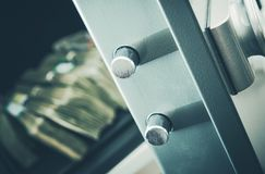 Money in Residential Safe. Money in the Residential Safe Box Closeup Photo. Cash Money Safe Deposit Stock Images