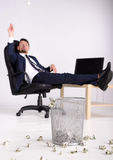 Money. Rich businessman having fun in his office. Just outside the money in the trash. White background Stock Photography