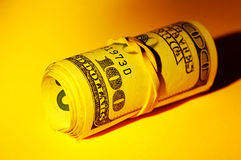 Money Roll. With Creative Lighting Stock Photography