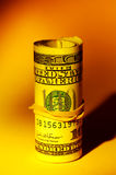 Money Roll. With Creative Lighting Royalty Free Stock Photo