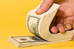 Money roll. Money series: roll of green dollar in hand Stock Photo
