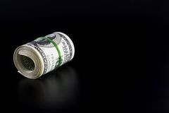 Money Roll with Blank Space. Dollars roll on a black background with smooth shadow and blank space for text Stock Photography