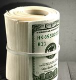Money Roll. Currency Wealth One Hundred Dollar Bill Savings Rolled Up US Paper Currency Royalty Free Stock Image