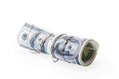Money of roll entwisted by gold Stock Image