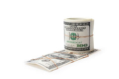 Money and roll of money entwisted by gold. On a white background isolated Royalty Free Stock Photos