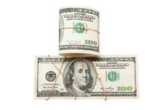 Money and roll of money entwisted by gold. On a white background isolated Royalty Free Stock Image