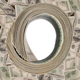 Money roll, roll of bills, roll of dollar bills. On dollars background Royalty Free Stock Photos