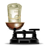 Money roll and scales Royalty Free Stock Images