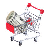 Money roll in shopping cart isolated on white. Dollar bills in trolley Stock Photography