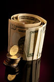 Money roll with US dollars, and euro coins  on white backgroun Royalty Free Stock Photo