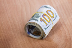 Money roll with US dollars Royalty Free Stock Image
