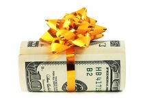 Money roll wrapped in a golden ribbon 2. Money roll wrapped in a golden ribbon with a bow on top Royalty Free Stock Photos