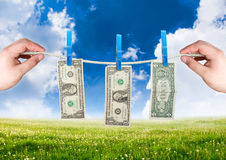 Money on the rope with hand Royalty Free Stock Image
