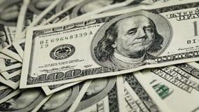 Money. Rotating 100 US dollars bank notes stock video