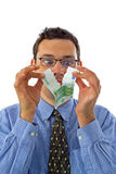 Money rupture. Male businessman tearing banknote in front of eyes Royalty Free Stock Photography