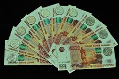 Money Russia green black background. A big pile of money on the wooden floor Stock Images