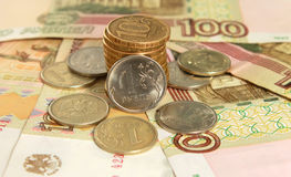 Money. Russian coins and banknotes on the yellow background Stock Image
